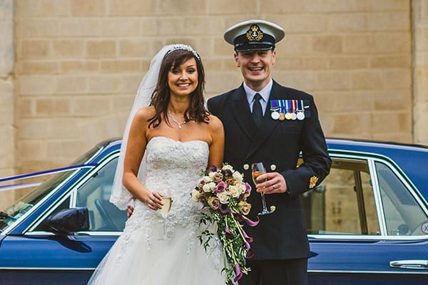 Newly-wed couple in front of Bentley Brooklands