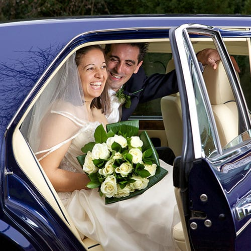 bride and groom in Azure Wedding Cars Bentley Brooklands