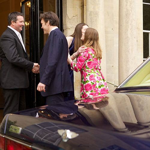 guests being greeted at door by Bentley Brooklands