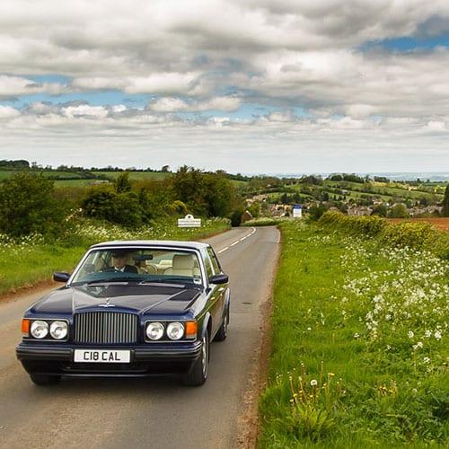 luxury Cheltenham wedding car chauffeur service drive down country lane