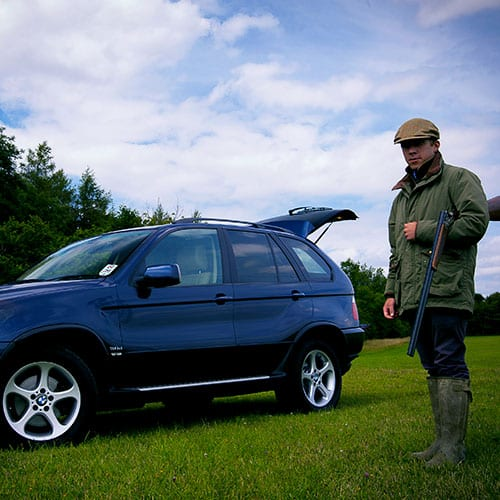 BMW X5 for stag party man with rifle