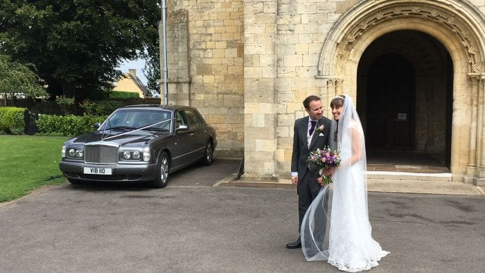 Newly-wed couple Alex and Rebecca with the Bentley Arnage