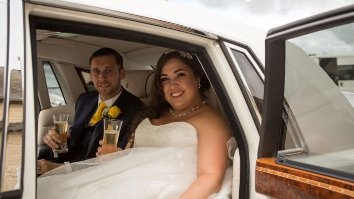 Newly-wed couple Chris and Hannah enjoying a glass of Champagne in the Rolls-Royce Phantom