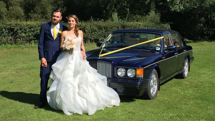 Colin and Tasha with the Bentley Brooklands and ribbons to match the wedding colour scheme