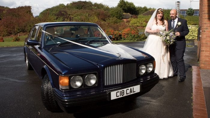 Newly-wed couple Garry and Julie with the Bentley Brooklands Wedding Car